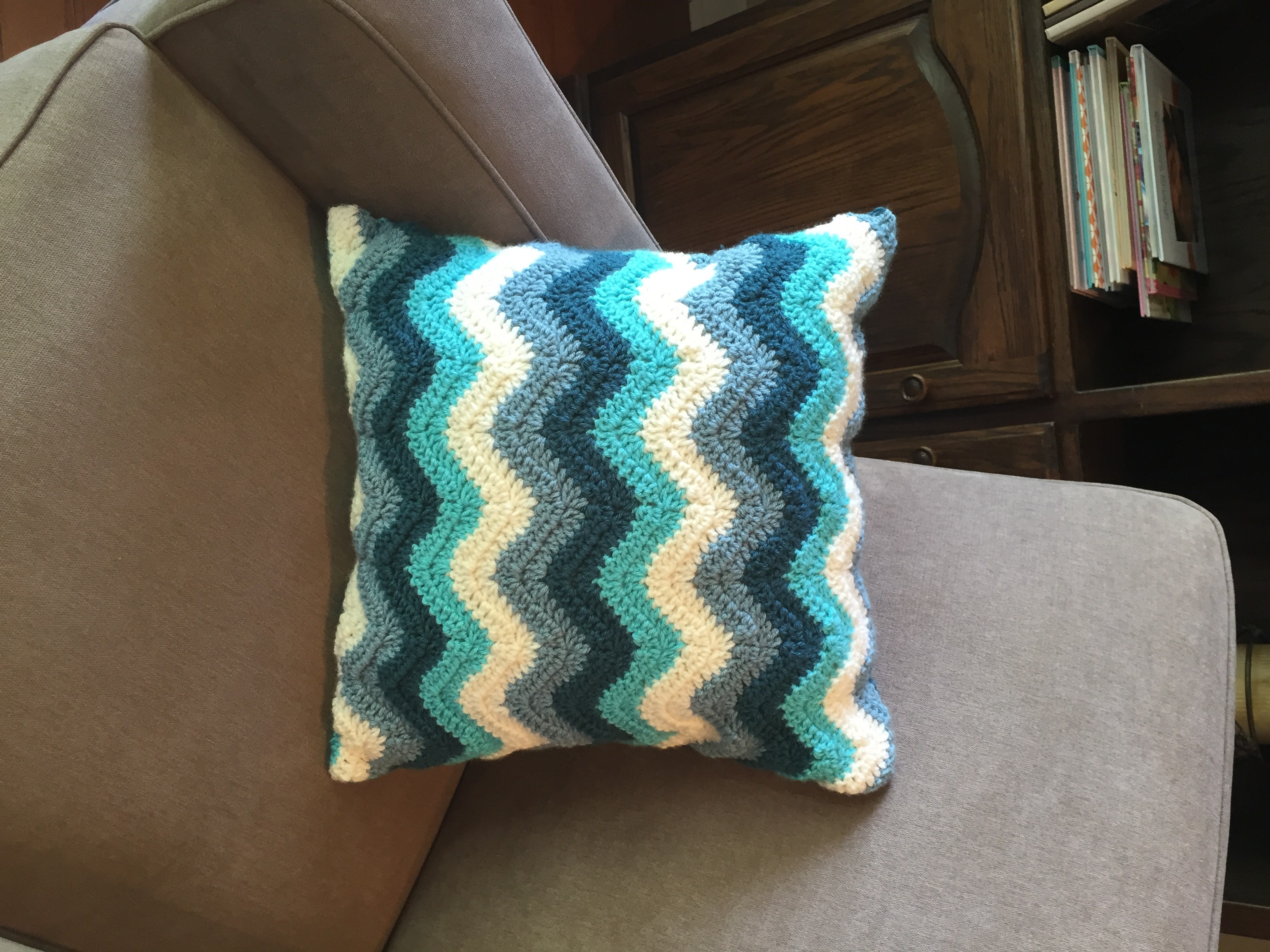Chevron pillow cover crochet pattern by little monkeys designs in brown chair