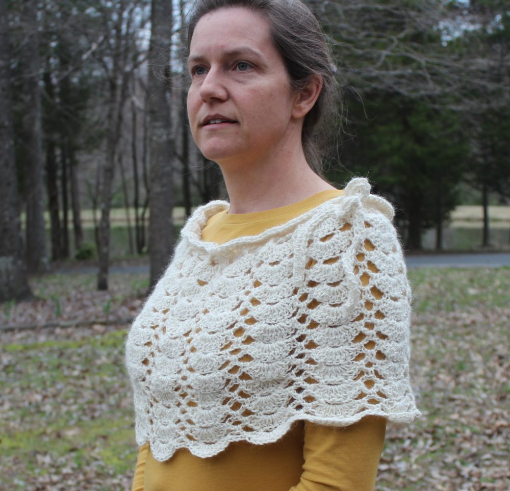 side view of lacy scallops shawl