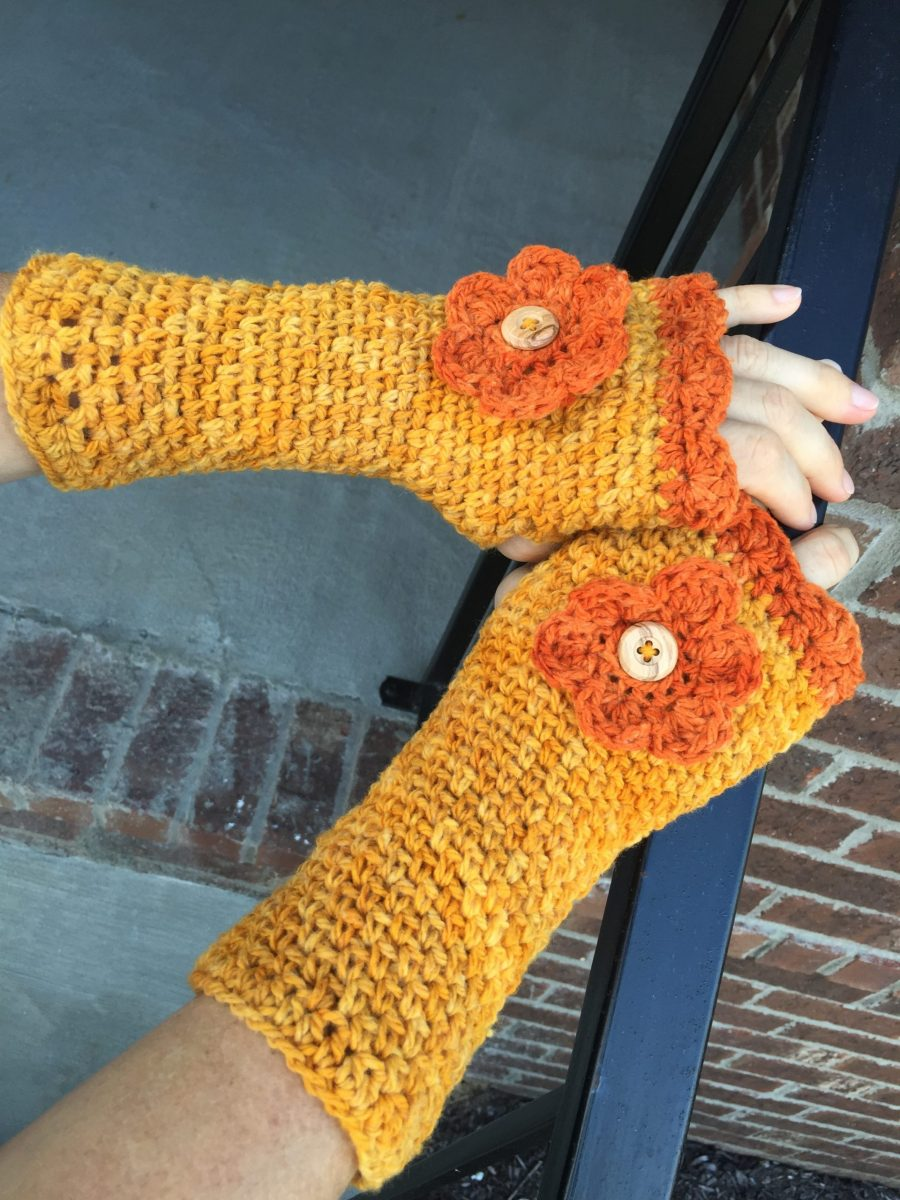 Shannons fingerless gloves with button flower in yellow and orange