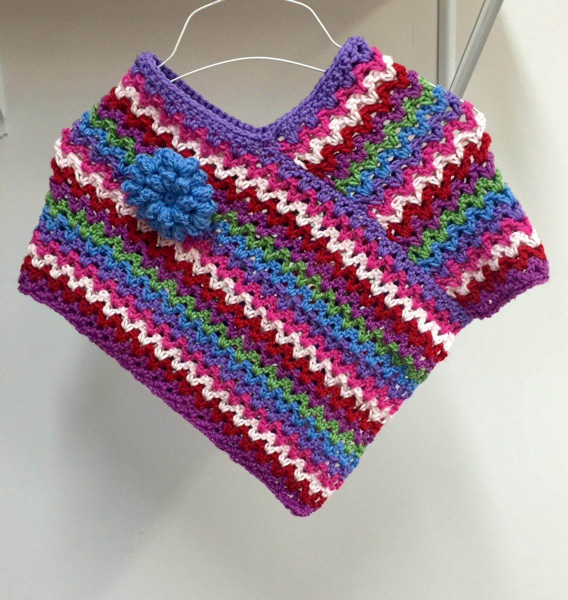 Rainbow Poncho crochet pattern by Little Monkeys Designs