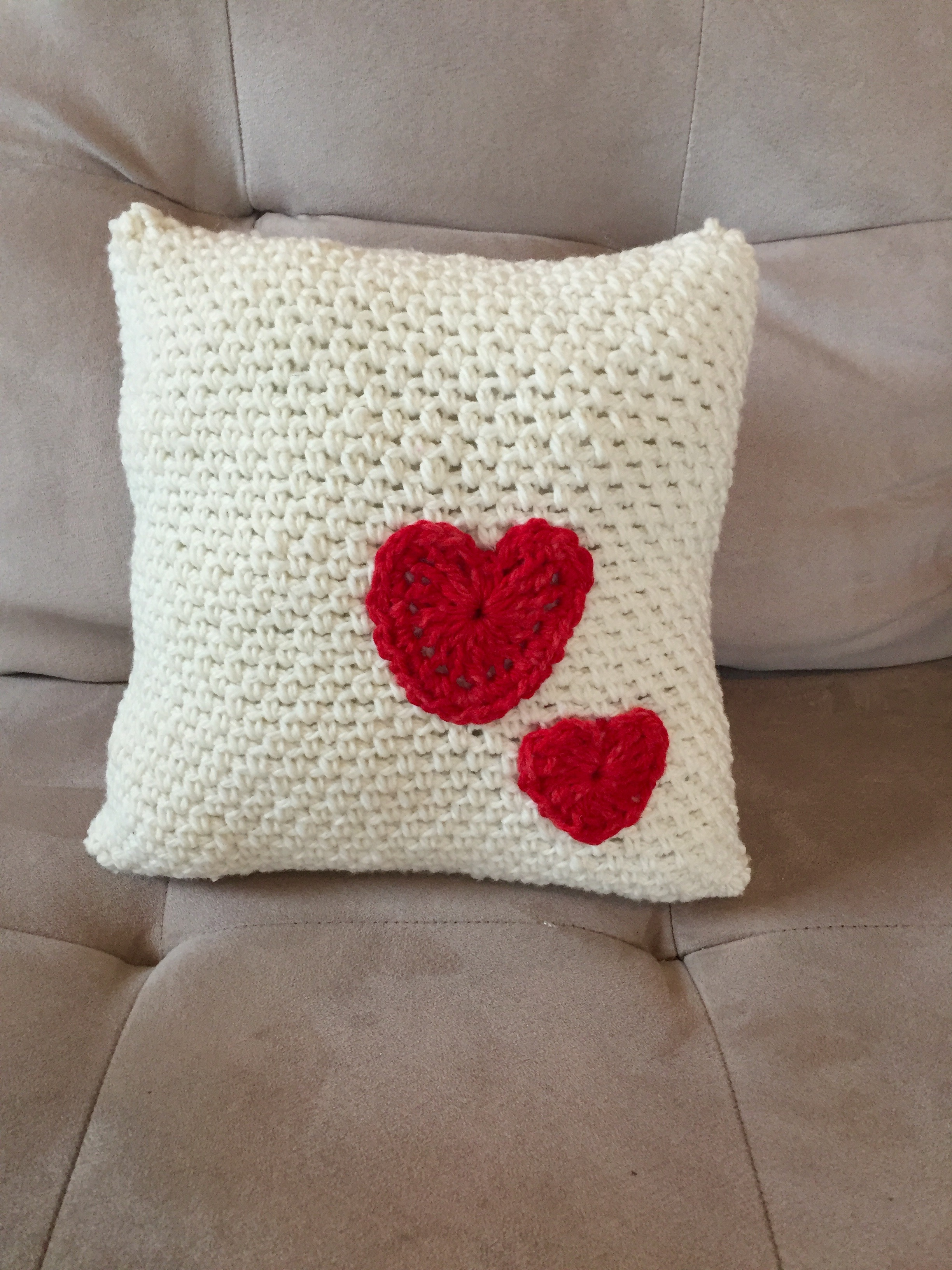 decorative pillow with hearts crochet in merino wool
