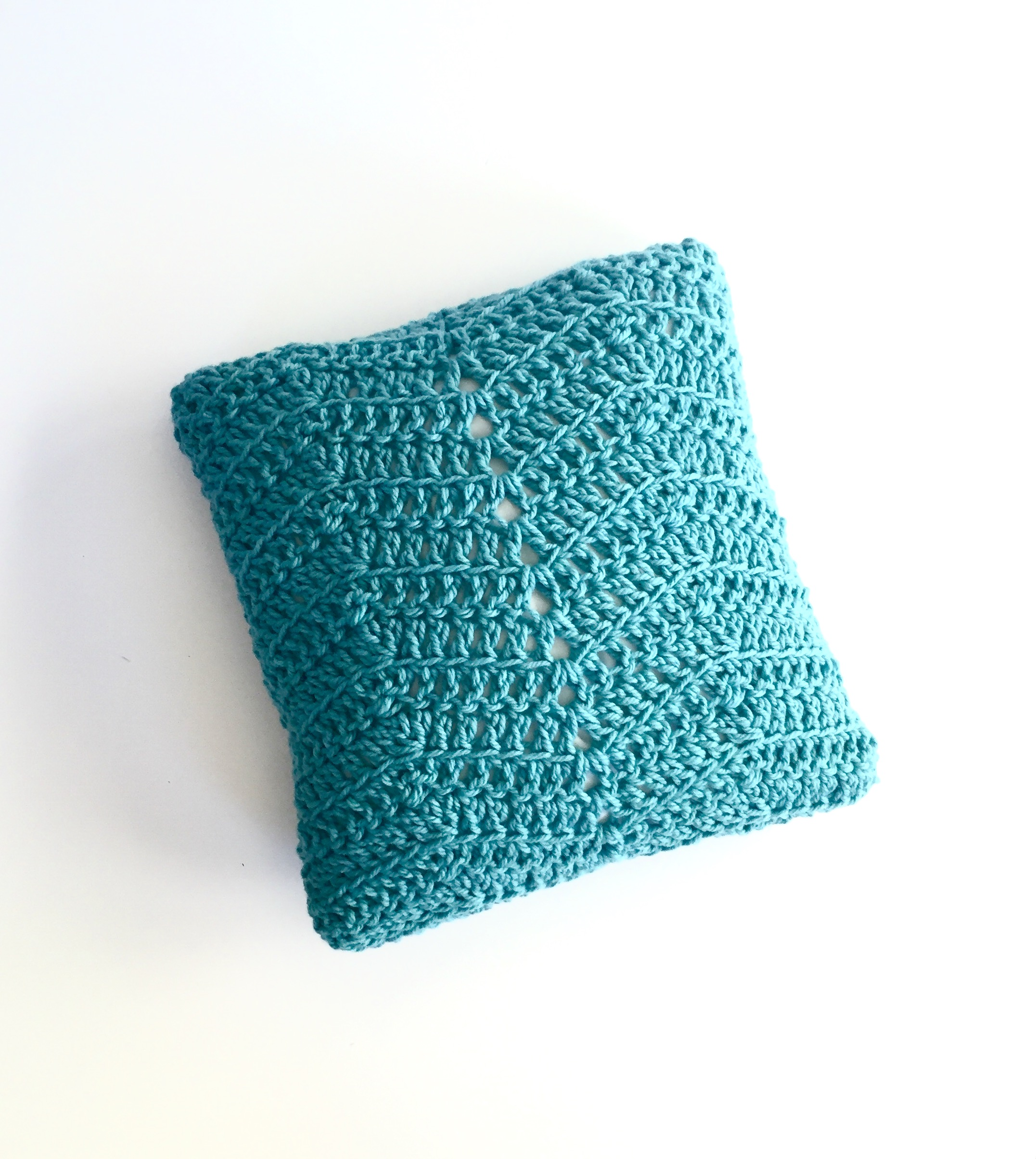 Cozy Comforts Pillow Cover Crochet Pattern on white