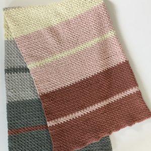 Dream Weaver blanket crochet pattern in pink merino.