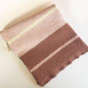 Dream Weaver blanket crochet pattern in chunky rose merino.