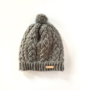 Dreaming of the Slopes crochet cable stitch hat pattern by Little Monkeys Design.