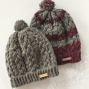 Dreaming of the slopes cable stitch hat in merino wool by Little Monkeys Design.