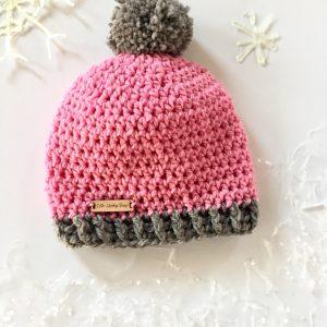 Pom-Pom Hat crochet pattern by Little Monkeys Design.