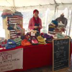 Wearing my wool knotted ear warmer to stay warm at a holiday market.