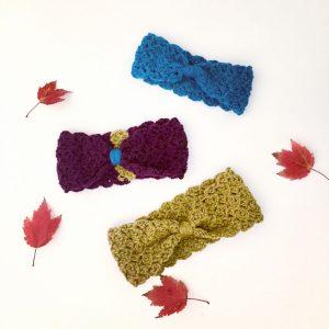 Wool knotted ear warmer by Little Monkeys Design.