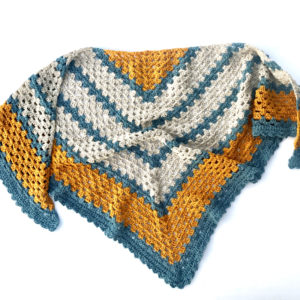 A Sunny Day triangle shawl crochet pattern by Little Monkeys Design. Shawl with a lacy edge. Triangle shawl crochet kit.