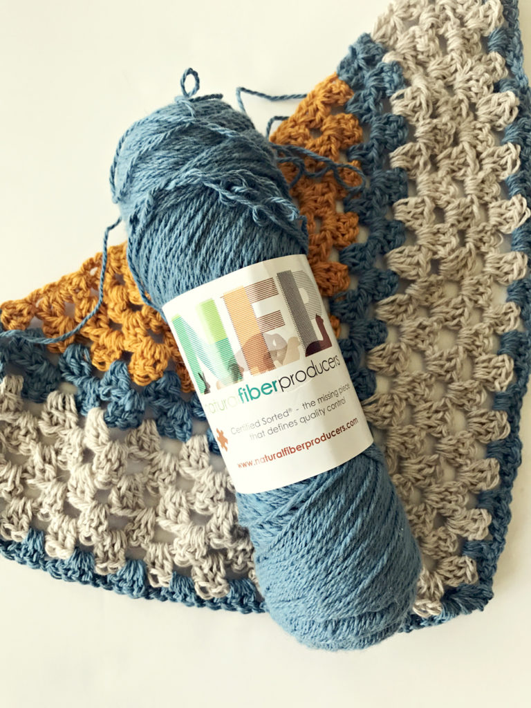 A Sunny Day Triangle Shawl crochet kit by Little Monkeys Design.