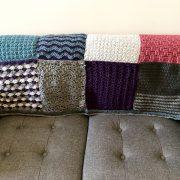 Sampler Blanket over love seat