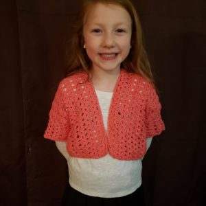 Girls cardigan crochet pattern by Little Monkeys Designs - pink spring cropped girls cardigan